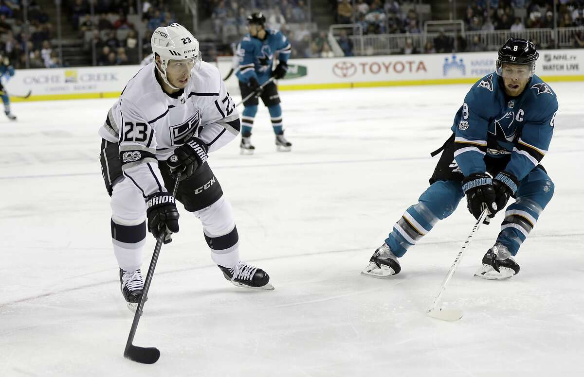 Los Angeles Kings' Dustin Brown (23) prepares to shoot and score past San Jose Sharks' Joe Pavelski (8) during the first period of an NHL hockey game Saturday, Oct. 7, 2017, in San Jose , Calif. (AP Photo/Marcio Jose Sanchez)