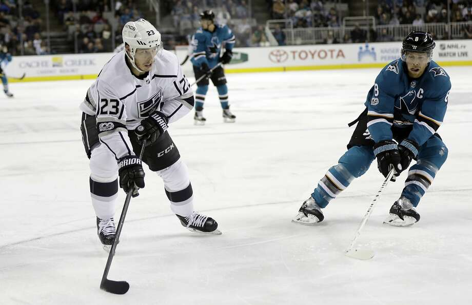 The Kings' Dustin Brown (23) prepares to shoot and score past the Sharks' Joe Pavelski (8) during the disastrous first period. Photo: Marcio Jose Sanchez, Associated Press