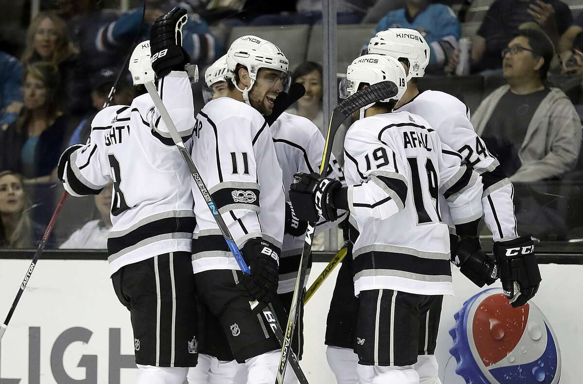 The Los Angeles Kings celebrate a goal by Dustin Brown during the first period of an NHL hockey game against the San Jose Sharks Saturday, Oct. 7, 2017, in San Jose , Calif. (AP Photo/Marcio Jose Sanchez)
