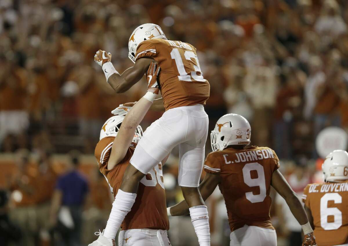 AUSTIN, TX - OCTOBER 07: Derek Kerstetter #68 of the Texas Longhorns celebrates with Jerrod Heard #13 after a touchdown in the first overtime period against the Kansas State Wildcats at Darrell K Royal-Texas Memorial Stadium on October 7, 2017 in Austin, Texas. (Photo by Tim Warner/Getty Images)