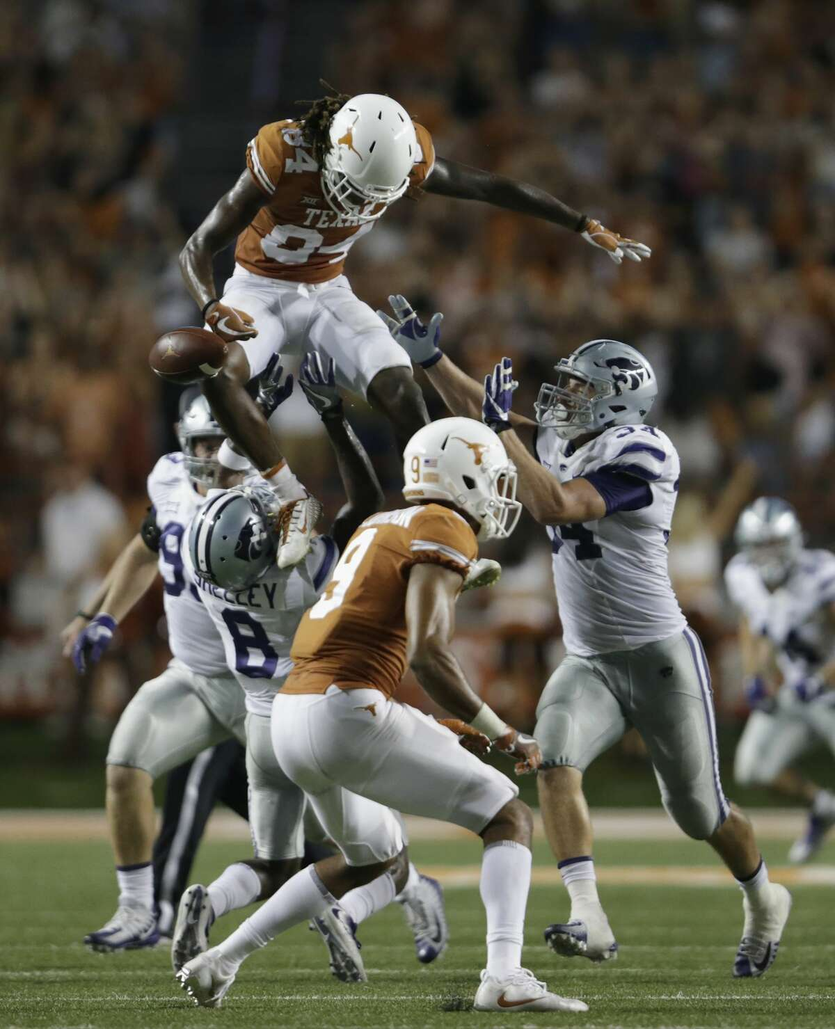 AUSTIN, TX - OCTOBER 07: Lil'Jordan Humphrey #84 of the Texas Longhorns fumbles the football after a hit by Duke Shelley #8 of the Kansas State Wildcats in the fourth quarter at Darrell K Royal-Texas Memorial Stadium on October 7, 2017 in Austin, Texas. (Photo by Tim Warner/Getty Images)