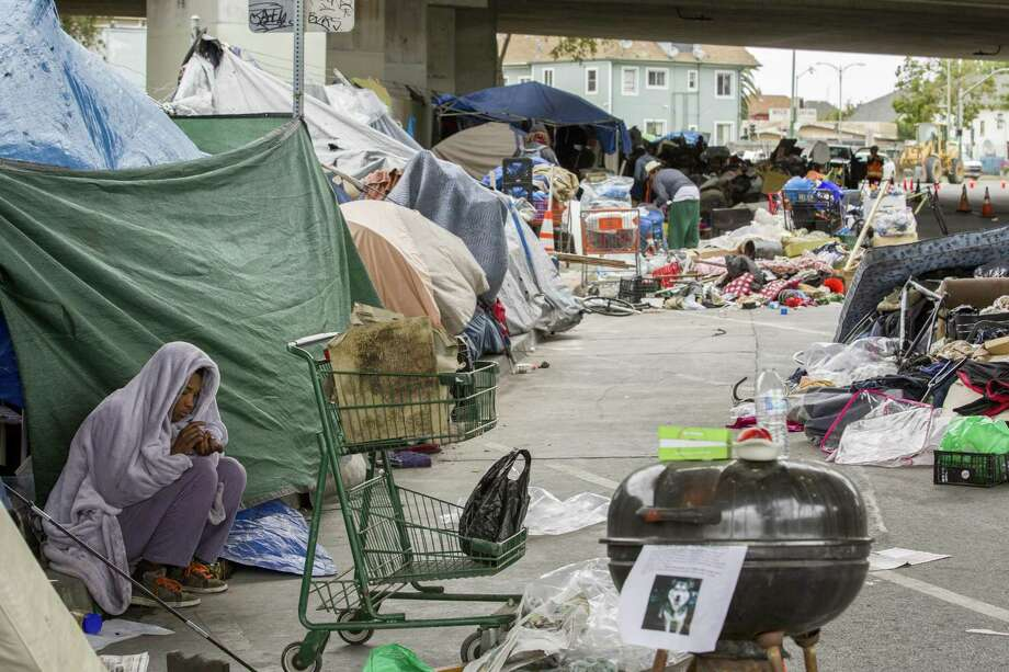 """As homeless camps proliferate like this one in May on Northgate Avenue and Sycamore Street, Oakland's City Council has voted to provide small """"safe haven"""" camp sites in secured areas with access to services. Photo: Santiago Mejia / Santiago Mejia / The Chronicle / ONLINE_YES"""