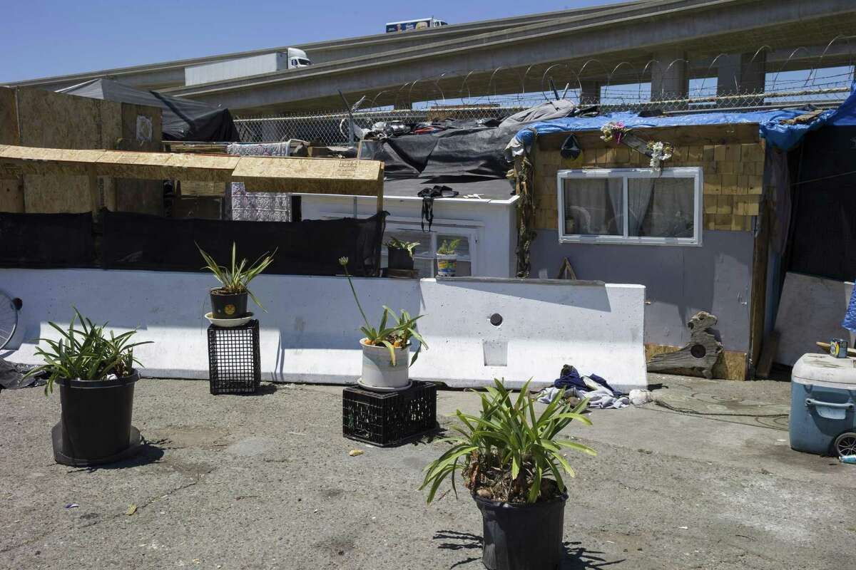 A homeless encampment flourished in June at 26th and Wood streets in Oakland.