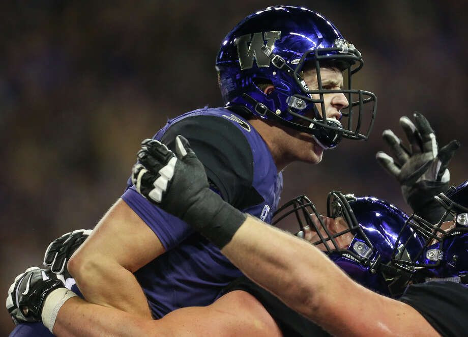 Washington quarterback Jake Browning celebrates running the ball in for a touchdown during the first half of an NCAA football game against California at Husky Stadium on Saturday, Oct. 7, 2017. Photo: GRANT HINDSLEY, SEATTLEPI.COM / SEATTLEPI.COM