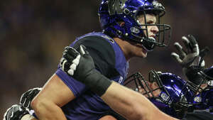 Washington quarterback Jake Browning celebrates running the ball in for a touchdown during the first half of an NCAA football game against California at Husky Stadium on Saturday, Oct. 7, 2017.