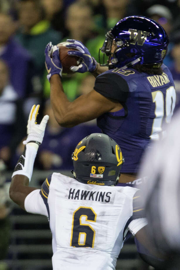 Washington tight end Hunter Bryant intercepts a pass meant for California wide receiver Jeremiah Hawkins during the first half of an NCAA football game at Husky Stadium on Saturday, Oct. 7, 2017. Photo: GRANT HINDSLEY, SEATTLEPI.COM / SEATTLEPI.COM