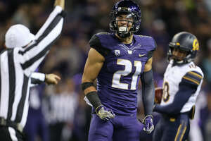 Washington defensive back Taylor Rapp celebrates after a tackle for a loss during the first half of an NCAA football game against California at Husky Stadium on Saturday, Oct. 7, 2017.