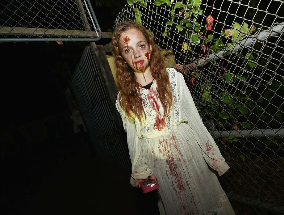 """The Haunted Isle"" at the Shore Line Trolley Museum at 17 River St.,  in East Haven, Saturday, Oct. 7, 2017. The spooky walk through the woods, rated ""S"" for scary, is in operation every Saturday and Sunday in the month of October. Trolleys depart continuously for the Isle from 7 – 10 pm. General admission tickets are $12 each and a limited number of express tickets are sold each night for $20 each. The oldest continuously running suburban trolley line in the USA, the Shoreline Trolley Museum is operated by Branford Electric Railway Association. Photo: Catherine Avalone, Hearst Connecticut Media / New Haven Register"