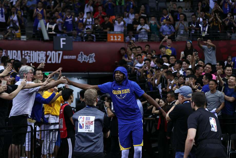 SHENZHEN, CHINA - OCTOBER 05:  Kevin Durant #35 of the Golden State Warriors enters the court before the game between the Minnesota Timberwolves and the Golden State Warriors as part of 2017 NBA Global Games China at Universidade Center on October 5, 2017 in Shenzhen, China.  (Photo by Zhong Zhi/Getty Images) Photo: Zhong Zhi, Getty Images