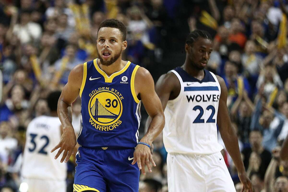 Stephen Curry #30 of the Golden State Warriors celebrates during the game between the Minnesota Timberwolves and the Golden State Warriors as part of 2017 NBA Global Games China at Mercedes-Benz Arena on October 8, 2017 in Shanghai, China. (Photo by Zhong Zhi/Getty Images)