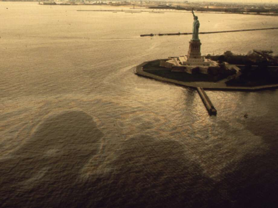 An oil slick surrounding the Statue of Liberty. The photo comes from the EPA's 'Documerica' series, documenting pollution in America from the late 1960s to the end of the 1970s. Photo: Chester Higgins/Documerica