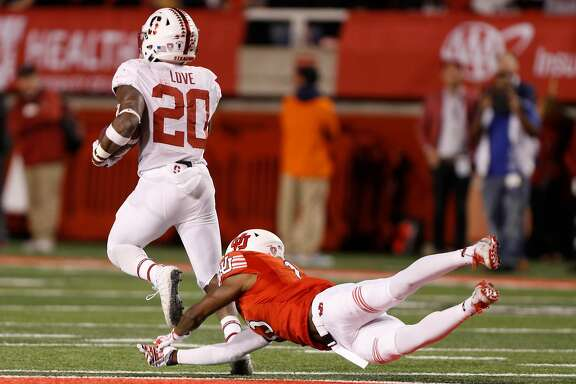 SALT LAKE CITY, UT - OCTOBER 7: Running back Bryce Love (20) of the Stanford Cardinal breaks a tackle of defensive back Marquise Blair (13) of the Utah Utes and runs for a touchdown during the first half of an college football game on October 7, 2017 at Rice Eccles Stadium in Salt Lake City, Utah. (Photo by George Frey/Getty Images)