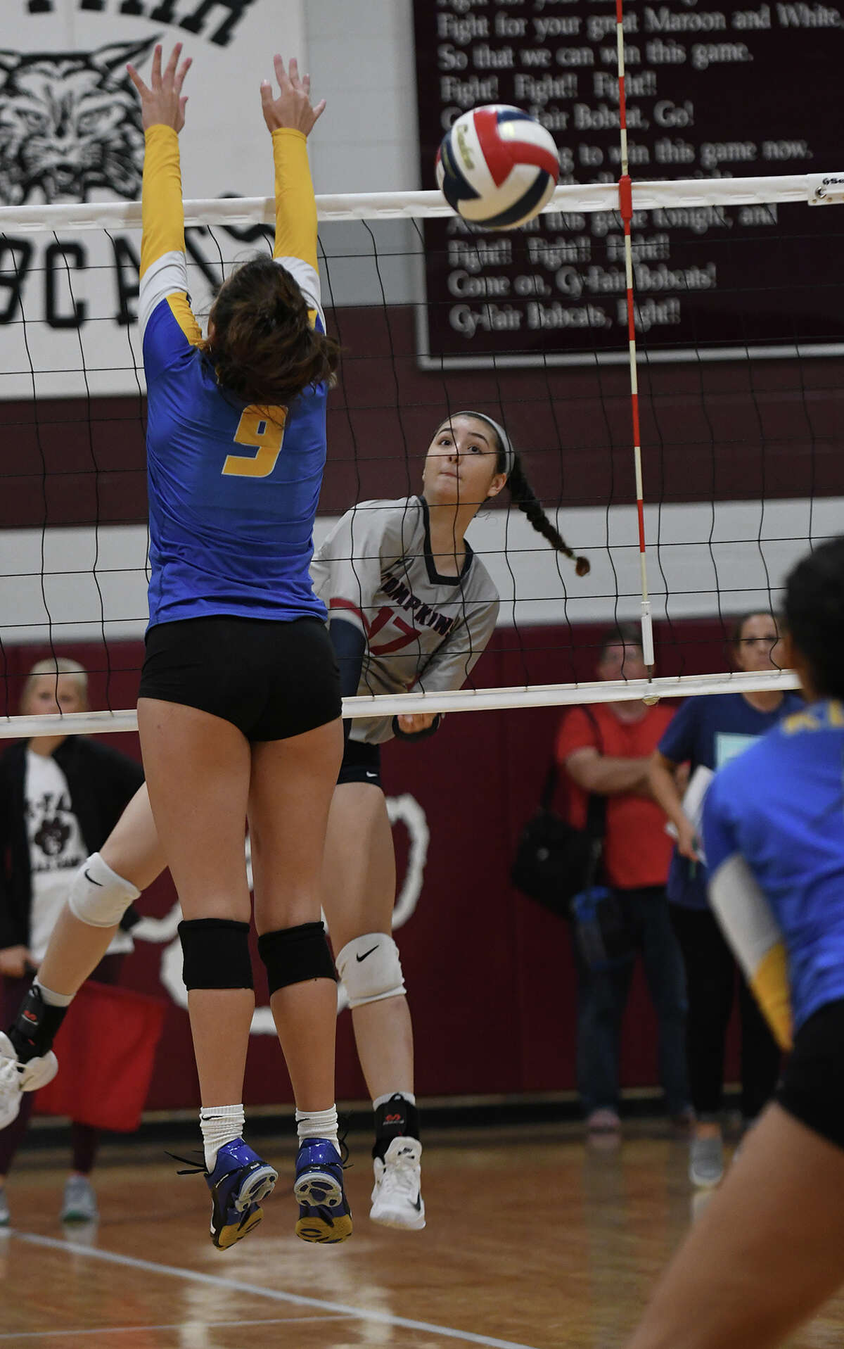 Tompkins junior outside hitter Moyra Zulaica, right, works at the net against Klein senior middle blocker Abby Hinojosa (9) during their match on day three of the John Turner Classic at Cy-Fair High School on Aug. 12, 2017. (Photo by Jerry Baker)