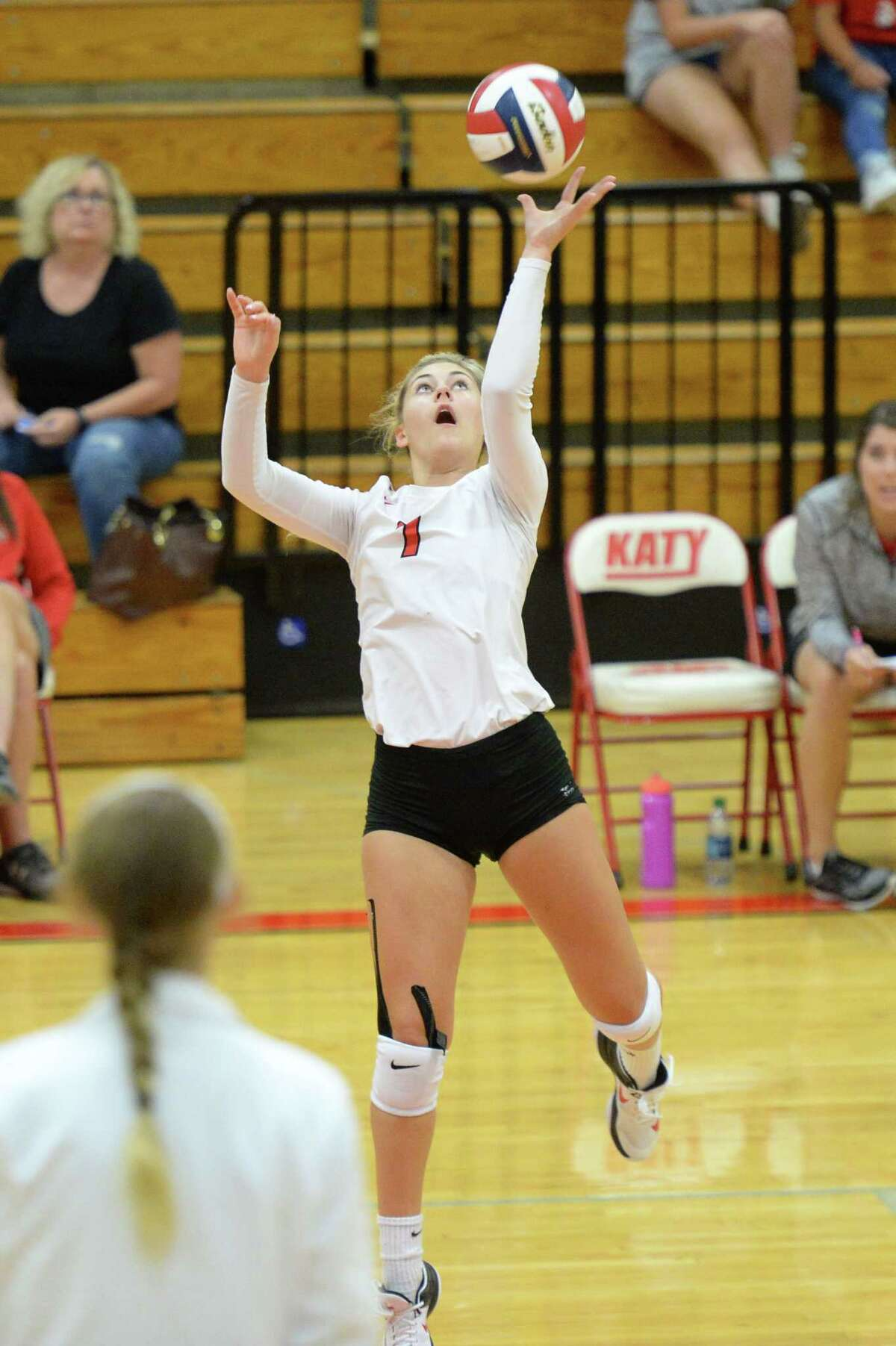 Autumn Gentry (7) of Katy tips a ball over the net in the first set of a high school volleyball game between the Katy Tigers and the Travis Tigers during the 2017 Cy-Fair ISD/Katy ISD Classic on August 10, 2017 at Katy High School, Katy, TX.