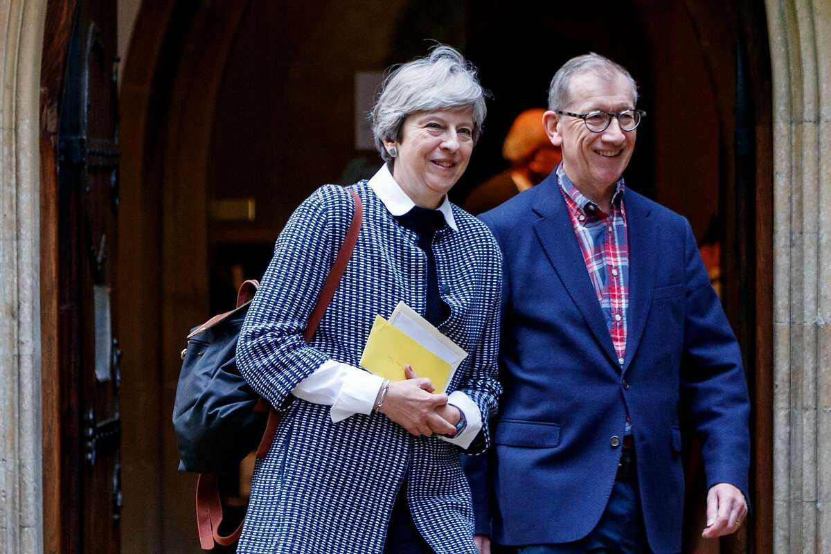 British Prime Minister Theresa May (L) and her husband Philip May (R) leave after attending the Sunday morning service at a church in her Maidenhead constituency in Berkshire, east of Reading in southern England, on October 8, 2017. British Prime Minister Theresa May is to meet business chiefs on October 9 in a bid to reassure them that the Brexit process is on track, following a bruising week for her leadership. A plot to oust her by around 30 MPs in her Conservative Party went public on October 6, but cabinet colleagues refused to join the push. The plot came after her showpiece speech to the centre-right party's annual conference on October 4 -- intended to steady her leadership -- was plagued by mishaps. / AFP PHOTO / Tolga AKMENTOLGA AKMEN/AFP/Getty Images