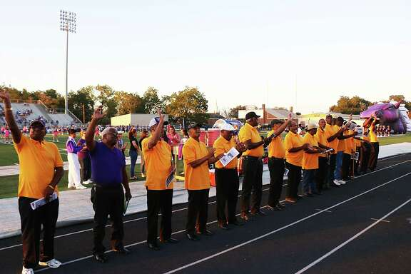 Members of the Colbert Tigers championship football team and friends receive the cheers of a grateful Dayton crowd at the football game last Friday night. The Tigers are celebrated their 50th anniversary last year.