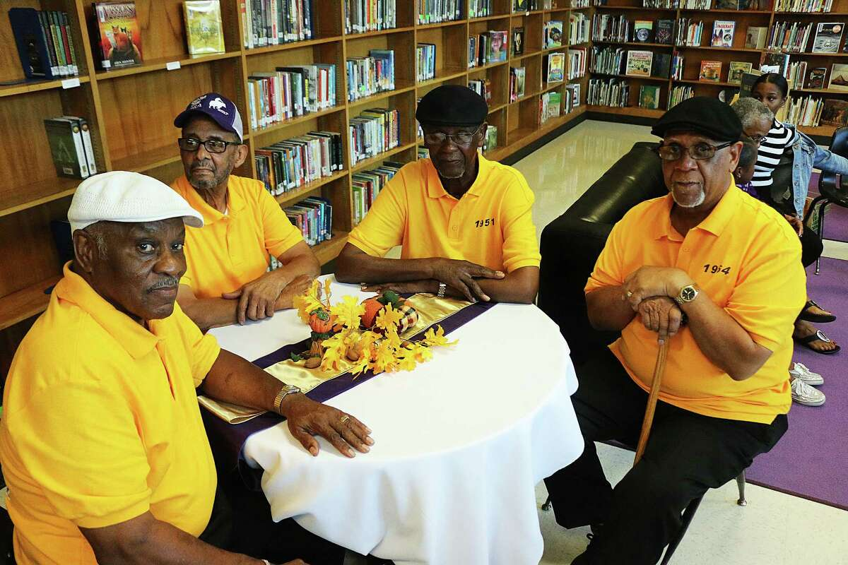 Friends George Brown, Stanley Barrett, Edward Foster and Oscar Grays sit at the table and chat about the old days.