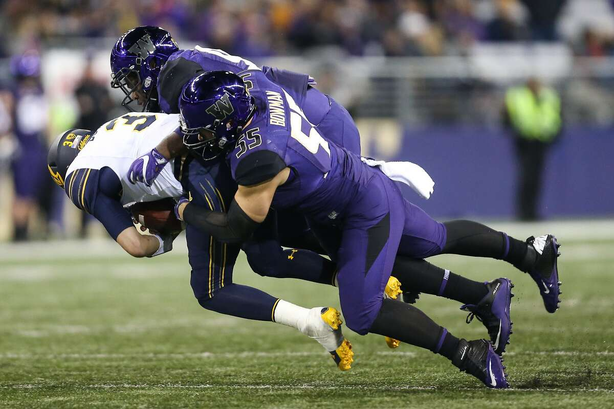 Washington defensive lineman Greg Gaines and outside linebacker Ryan Bowman hit California quarterback Ross Bowers during the second half of an NCAA football game between Washington and California at Husky Stadium on Saturday, Oct. 7, 2017. (GRANT HINDSLEY, seattlepi.com)