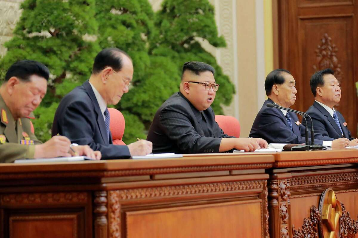 This photo taken on October 7, 2017 and released on October 8, 2017 by North Korea's official Korean Central News Agency (KCNA) shows North Korean leader Kim Jong-Un (C) attending the Second Plenum of the 7th Central Committee of the Workers' Party of Korea (WPK) in Pyongyang. / AFP PHOTO / KCNA VIA KNS / STR / South Korea OUT / REPUBLIC OF KOREA OUT ---EDITORS NOTE--- RESTRICTED TO EDITORIAL USE - MANDATORY CREDIT