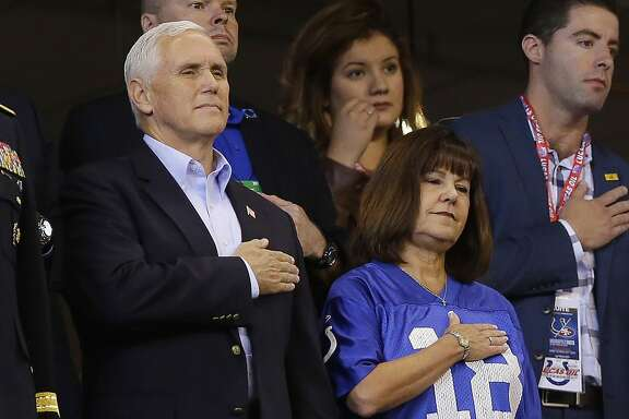 Vice President Mike Pence stands during the playing of the national anthem before an NFL football game between the Indianapolis Colts and the San Francisco 49ers, Sunday, Oct. 8, 2017, in Indianapolis. (AP Photo/Michael Conroy)