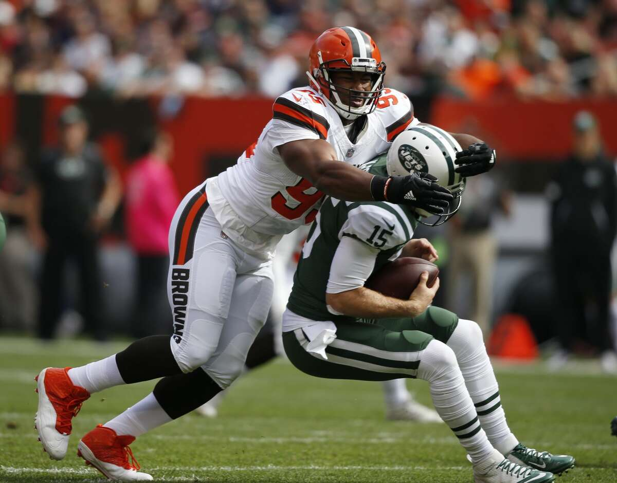 Cleveland Browns defensive end Myles Garrett, left, sacks New York Jets quarterback Josh McCown during the first half of an NFL football game, Sunday, Oct. 8, 2017, in Cleveland. (AP Photo/Ron Schwane)