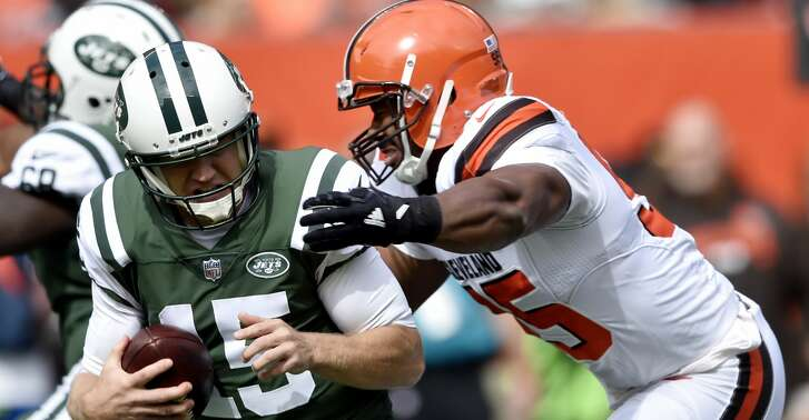 Cleveland Browns defensive end Myles Garrett, right, sacks New York Jets quarterback Josh McCown during the first half of an NFL football game, Sunday, Oct. 8, 2017, in Cleveland. (AP Photo/David Richard)