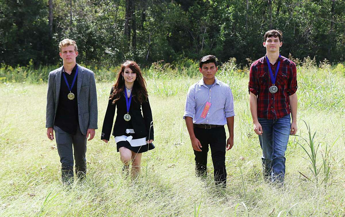 Dayton debate team members from left, Mark Richter, Lilly LeBouef, Gus Villordo, and Ethan Ives.