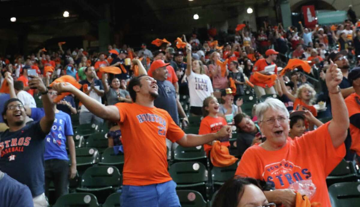 Houston Astros fans celebrate Carlos Correa's two-run home run during the top first inning against Boston Red Sox during the watch party at Minute Maid Park on Sunday, Oct. 8, 2017, in Houston.