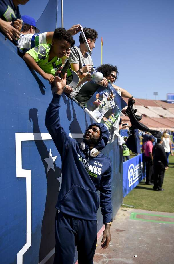 Seattle Seahawks wide receiver Paul Richardson sign autographs before an NFL football game against the Los Angeles Rams Sunday, Oct. 8, 2017, in Los Angeles. (AP Photo/Mark J. Terrill) Photo: Mark J. Terrill/AP