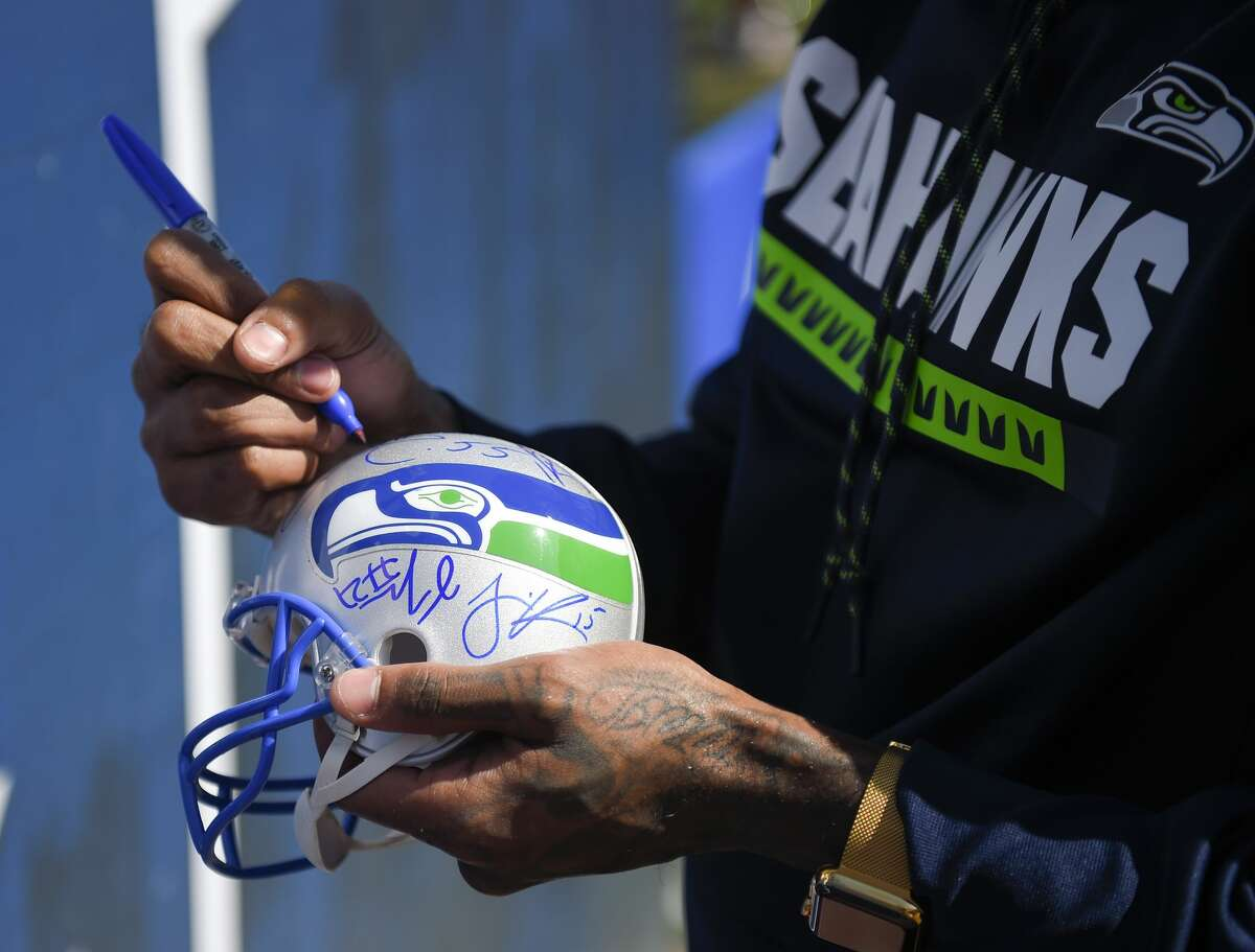 Seattle Seahawks wide receiver Paul Richardson sign autographs before an NFL football game against the Los Angeles Rams Sunday, Oct. 8, 2017, in Los Angeles. (AP Photo/Mark J. Terrill)