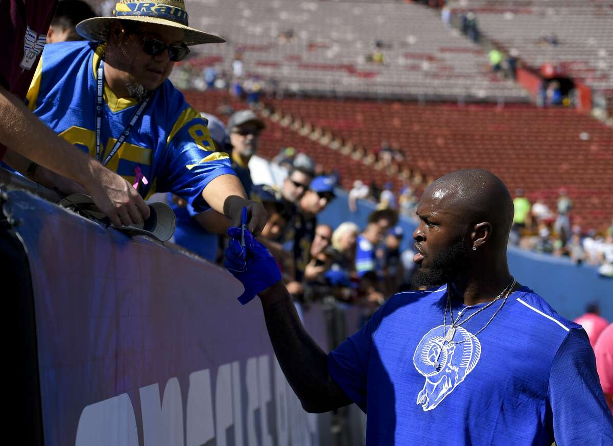 Los Angeles Rams inside linebacker Alec Ogletree signs autographs before an NFL football game against the Seattle Seahawks Sunday, Oct. 8, 2017, in Los Angeles. (AP Photo/Mark J. Terrill)