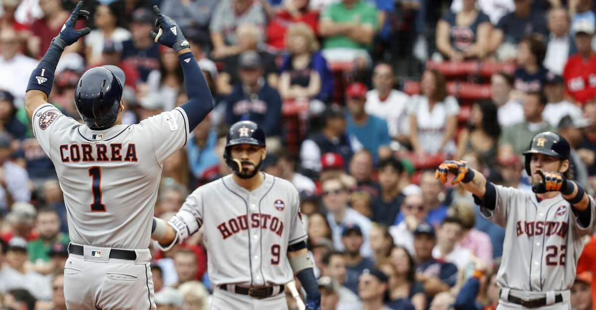 Houston Astros shortstop Carlos Correa (1), Marwin Gonzalez )9) and Josh Reddick (220 celebrate Correa's two-run home run off Boston Red Sox starter Doug Fister during the first inning of the ALDS Game 3 at Fenway Park, Sunday, Oct. 8, 2017, in Boston . ( Karen Warren / Houston Chronicle )
