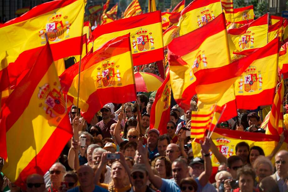 "Demonstrators wave Spanish flags during a rally in Barcelona to reinforce the unity of Spain. The crowd chanted, ""Don't be fooled, Catalonia is Spain."" Photo: JORGE GUERRERO, AFP/Getty Images"