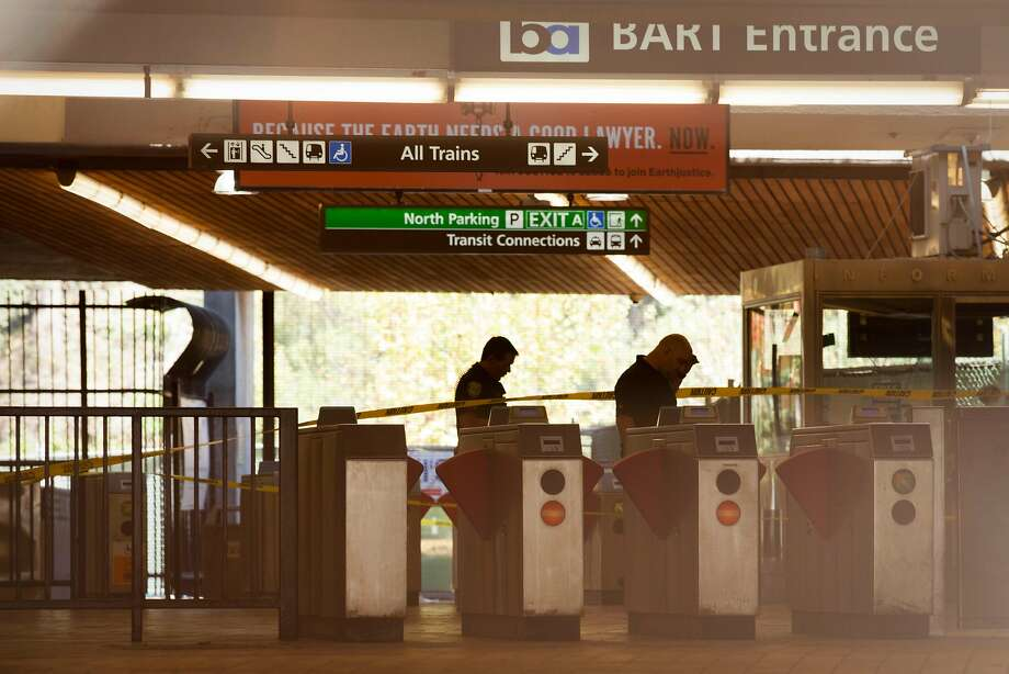 Bart Police officers in the main ticket area of the Lafayette BART Station where two people were stabbed around 10 a.m. Sunday. Photo: Peter DaSilva, Special To The Chronicle