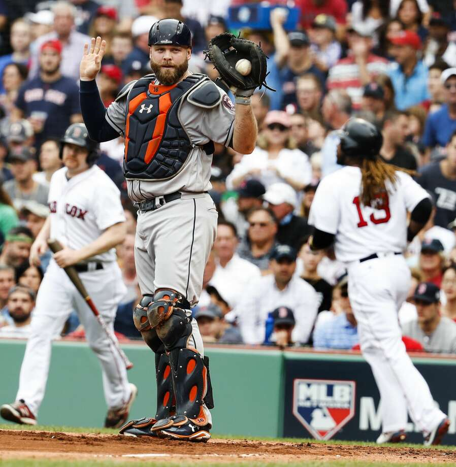 Houston Astros catcher Brian McCann calls time after forcing out Boston Red Sox designated hitter Hanley Ramirez (13) at home on a grounder by Boston Red Sox shortstop Xander Bogaerts during the second inning of the ALDS Game 3 at Fenway Park, Sunday, Oct. 8, 2017, in Boston .  ( Karen Warren / Houston Chronicle ) Photo: Karen Warren/Houston Chronicle