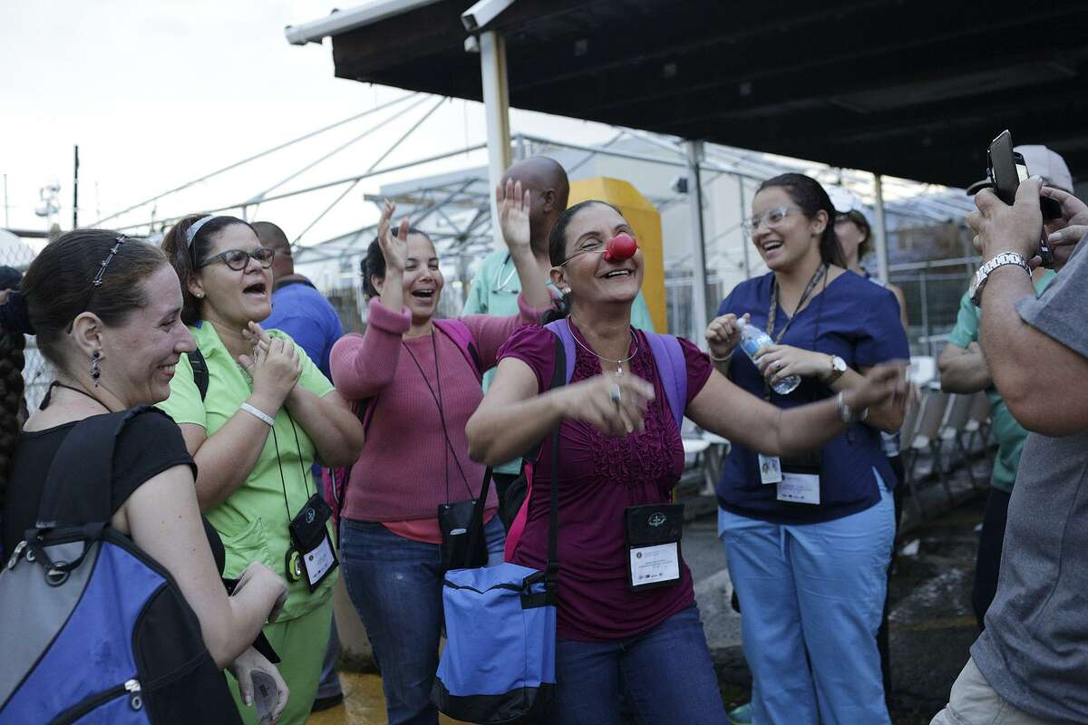 Counselor Miriam Soba Peterson entertains her colleagues as they wait to board the ferry in Fajardo to travel eight miles to the island of Vieques, Puerto Rico on Friday, Oct. 6, 2017. The group made of up of 28 medical professionals of varying disciplines has been volunteering every day in different communities hit hardest by Hurricane Maria. Nine other teams are doing the same throughout Puerto Rico.