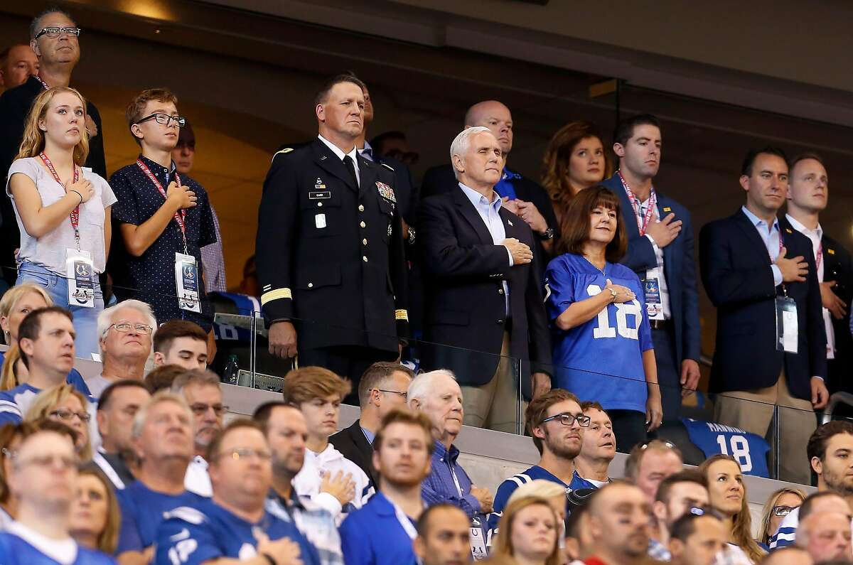 Vice President Mike Pence stands with his hand over his heart during the national anthem as the Indianapolis Colts play host the San Francisco 49ers at Lucas Oil Stadium on Sunday, Oct. 8, 2017, in Indianapolis.