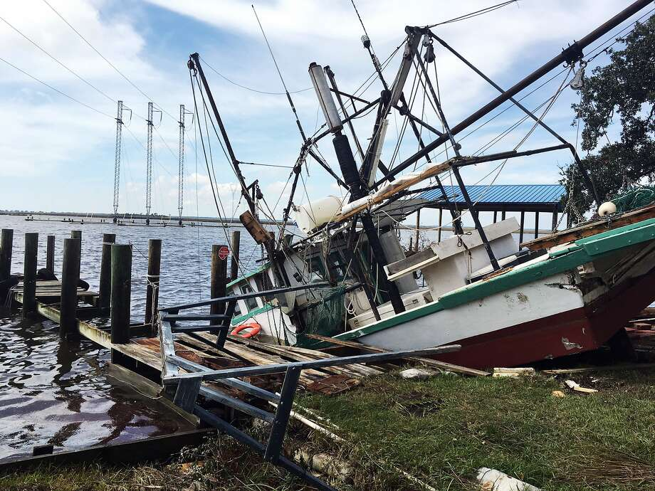 A shrimp boat is damaged at its mooring on the Pascagoula River in Moss Point, Miss., after Hurricane Nate made landfall. The storm quickly weakened into a tropical depression. Photo: Jeff Amy, Associated Press
