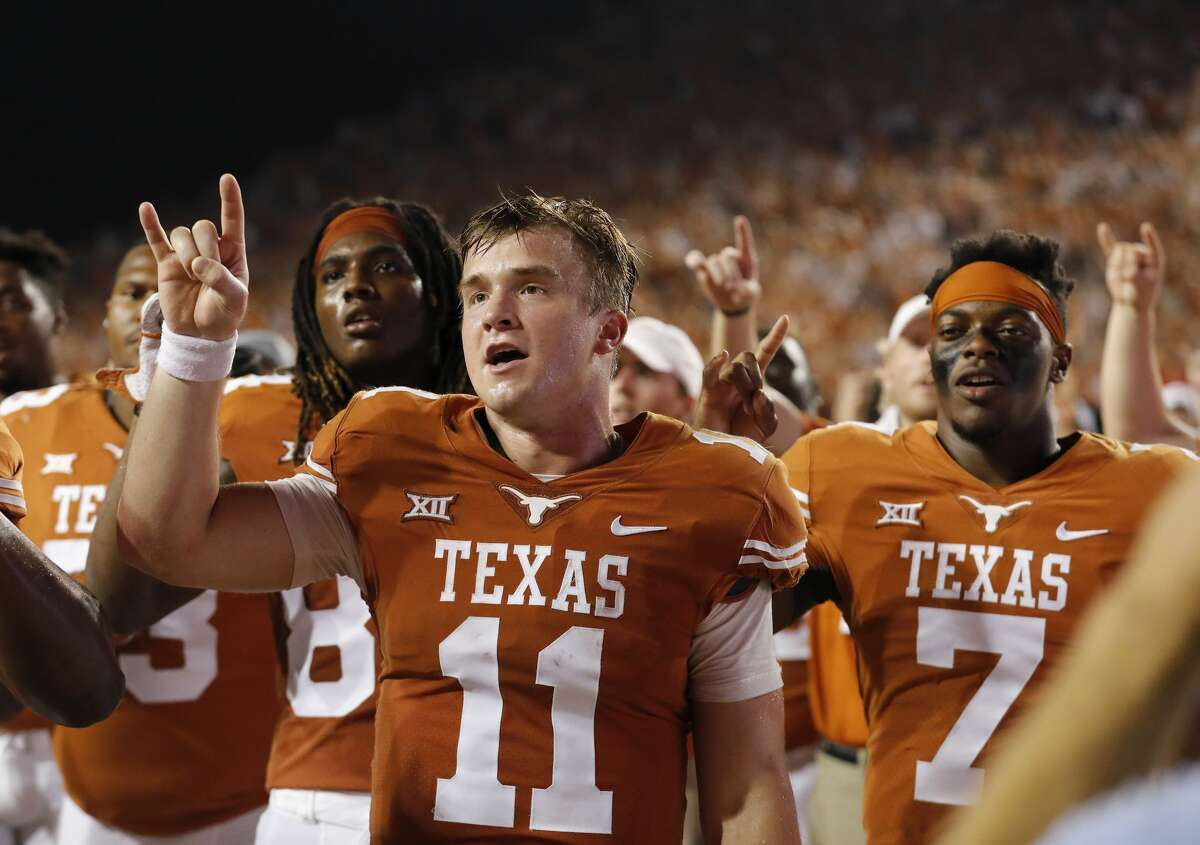 AUSTIN, TX - OCTOBER 07: Sam Ehlinger #11 of the Texas Longhorns and Antwuan Davis #7 sing The Eyes of Texas after the game against the Kansas State Wildcats at Darrell K Royal-Texas Memorial Stadium on October 7, 2017 in Austin, Texas. (Photo by Tim Warner/Getty Images)