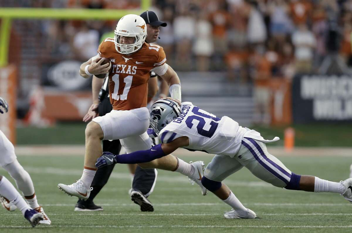 Texas quarterback Sam Ehlinger (11) tries to outrun the tackle of Kansas State defensive back Denzel Goolsby (20) during the first half of an NCAA college football game, Saturday, Oct. 7, 2017, in Austin, Texas. (AP Photo/Eric Gay)