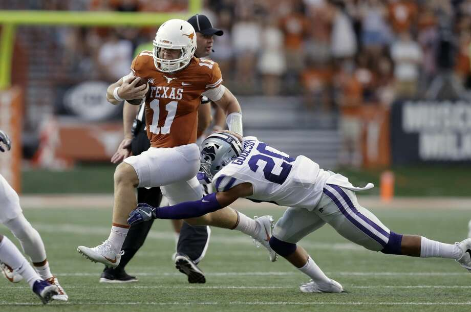 Texas quarterback Sam Ehlinger (11) tries to outrun the tackle of Kansas State defensive back Denzel Goolsby (20) during the first half of an NCAA college football game, Saturday, Oct. 7, 2017, in Austin, Texas. (AP Photo/Eric Gay) Photo: Eric Gay/Associated Press