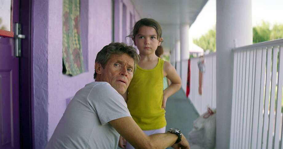 "Willem Dafoe, left, is a beleaguered hotel manager and Brooklynn Prince is the child of a young, overwhelmed mother played by Bria Vinaite in ""The Florida Project."" Photo: Associated Press"