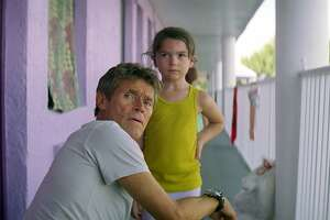 "This image released by A24 shows Willem Dafoe, left, and Brooklynn Prince in a scene from ""The Florida Project."" (A24 via AP)"