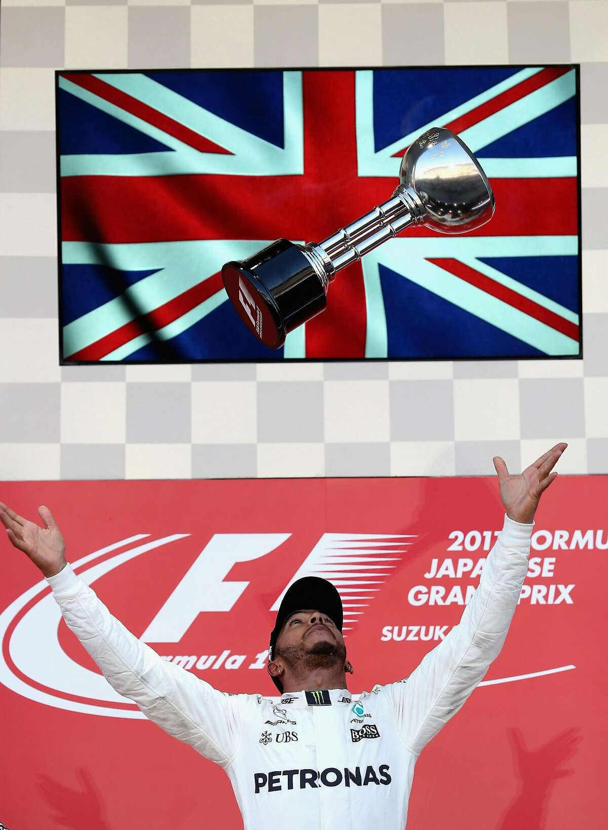 SUZUKA, JAPAN - OCTOBER 08: Race winner Lewis Hamilton of Great Britain and Mercedes GP celebrates on the podium during the Formula One Grand Prix of Japan at Suzuka Circuit on October 8, 2017 in Suzuka. (Photo by Mark Thompson/Getty Images) ***BESTPIX***
