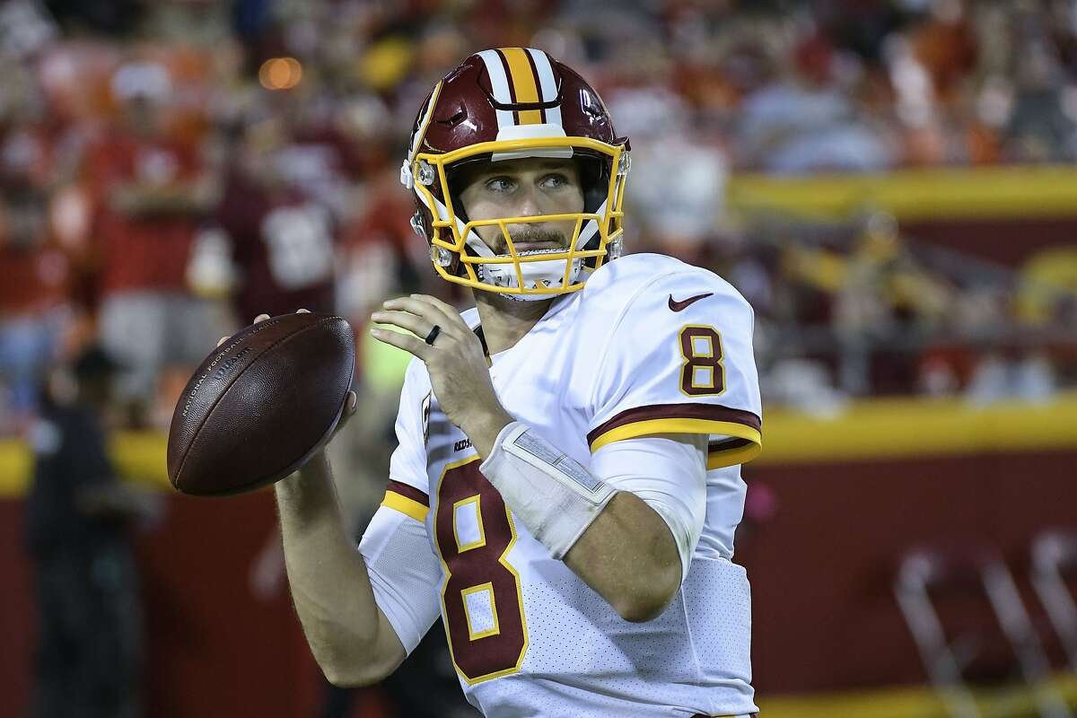 Washington Redskins quarterback Kirk Cousins (8) warmed up before the start of the second half of an NFL football game in Kansas City, Mo., Monday, October 2, 2017. (AP Photo/Reed Hoffmann)