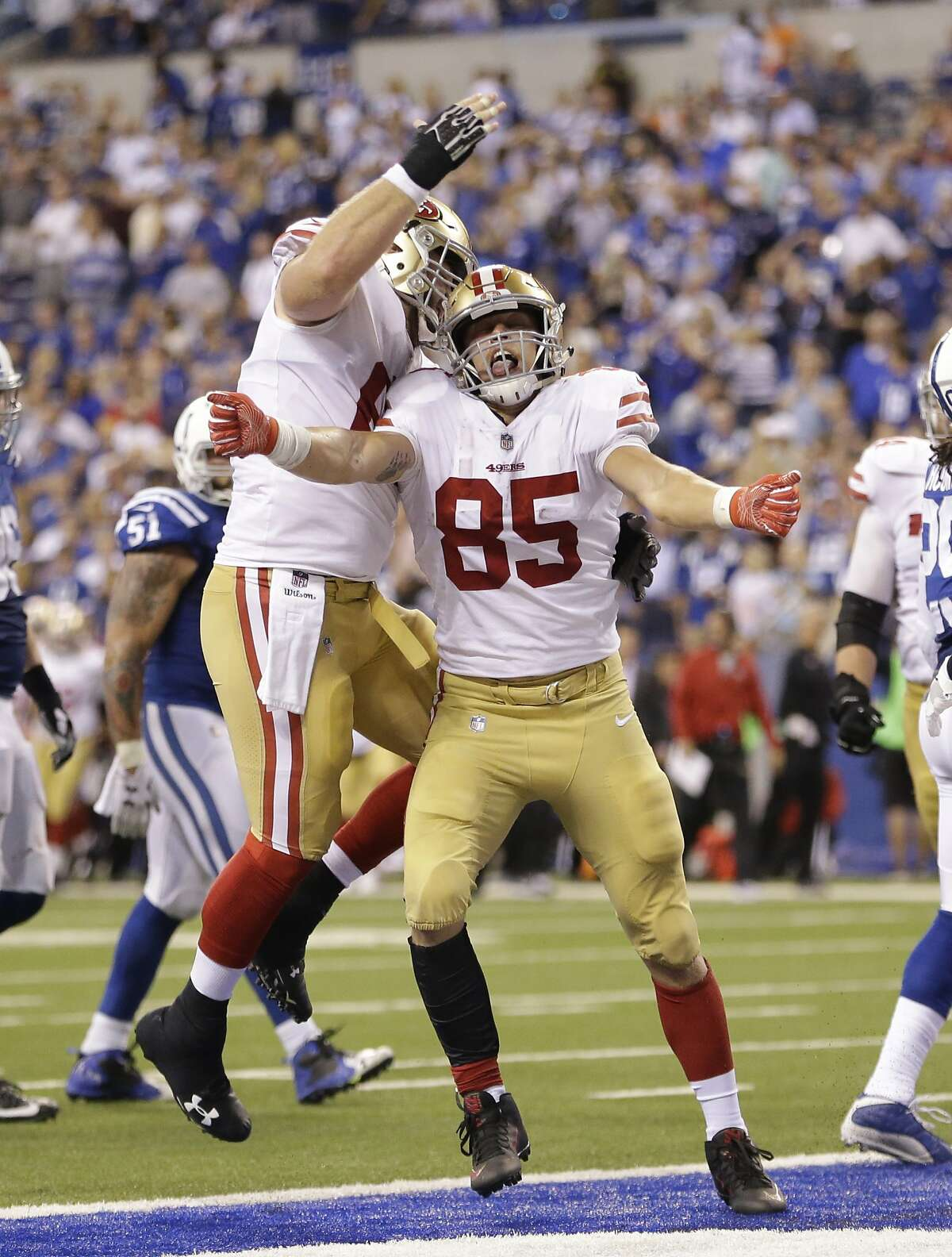 San Francisco 49ers' George Kittle (85) celebrates a five-yard touchdown reception during the second half of an NFL football game against the Indianapolis Colts, Sunday, Oct. 8, 2017, in Indianapolis. (AP Photo/AJ Mast)