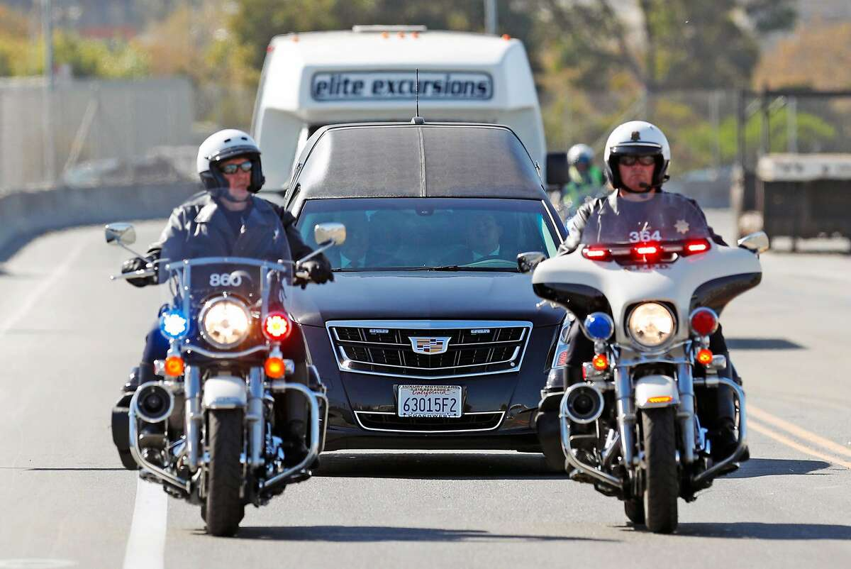 A motorcade leaves San Francisco International Airport as it escorts a hearse containing the body of Las Vegas shooting victim, Stacee Etcheber, in San Francisco, Calif., on Sunday, October 8, 2017.
