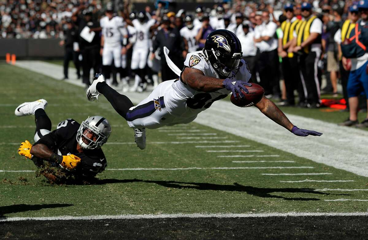 Ravens Vince Mayle (88) dives into the end zone for the Ravens' first touchdown in the first quarter as the Oakland Raiders played the Baltimore Ravens at the Oakland Coliseum in Oakland, Calif., on Sunday, October 8, 2017.
