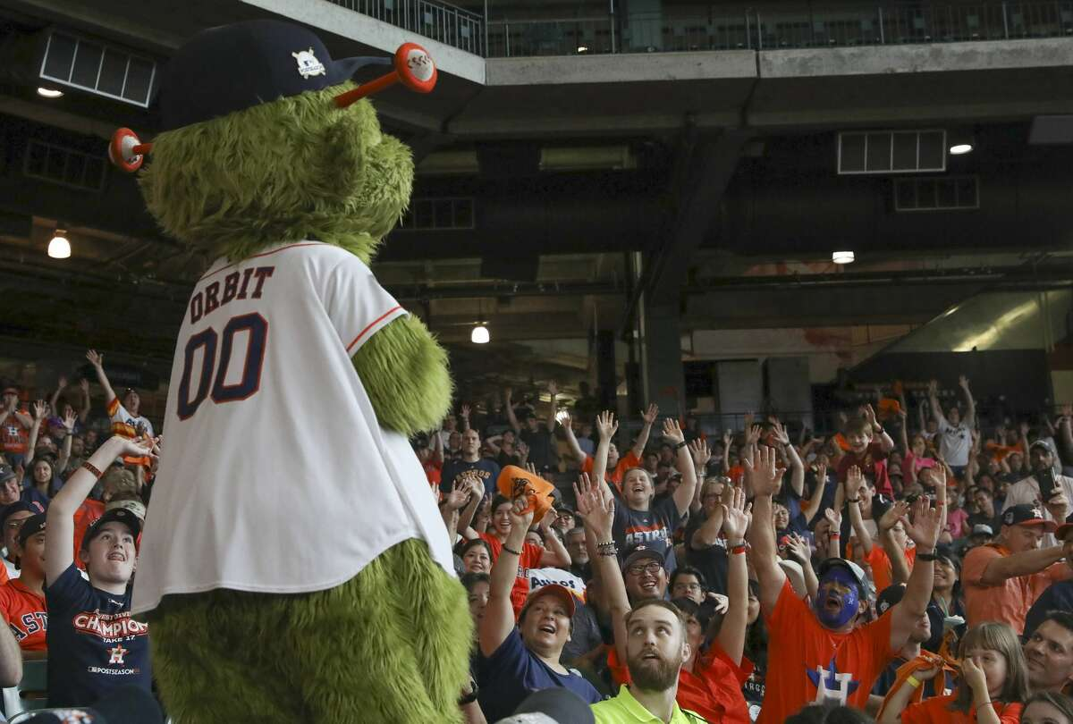 Houston Astros fans trying to get mascot Orbit's attention for a t-shirt at the watch party during the ALDS Game 3 against Boston Red Sox watch party at Minute Maid Park Sunday, Oct. 8, 2017, in Houston. ( Yi-Chin Lee / Houston Chronicle )