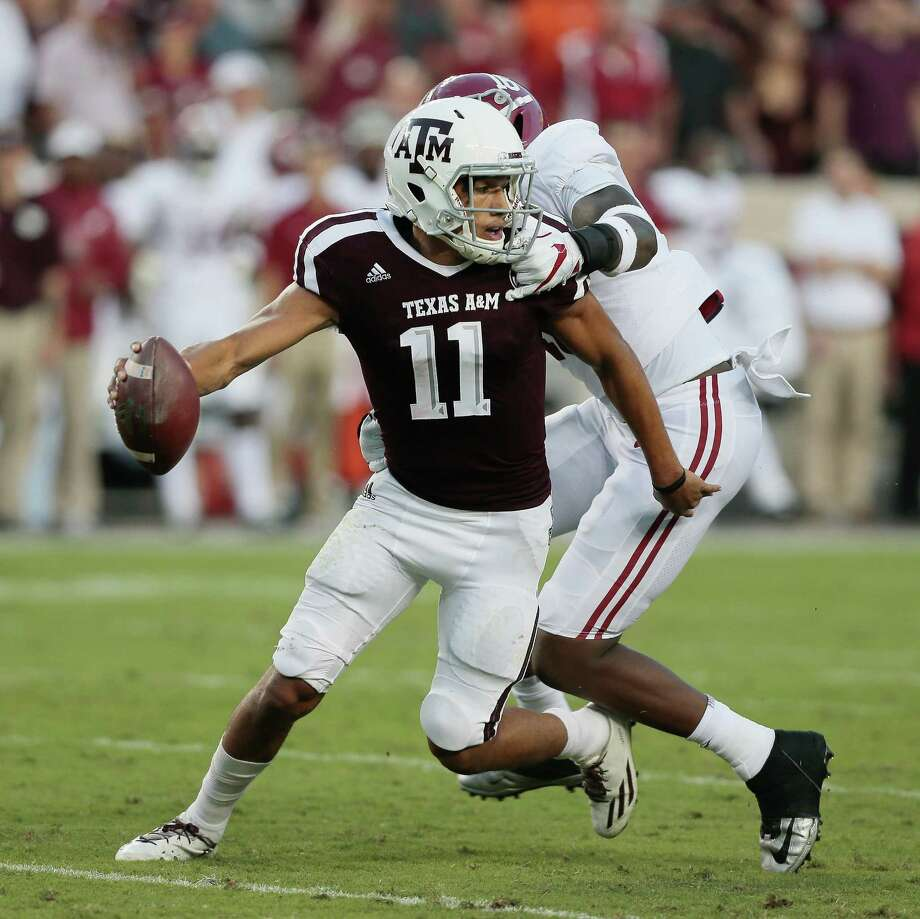 The Alabama defense had Texas A&M's Kellen Mond on the run Saturday, but the freshman quarterback channeled his inner Johnny Manziel when he had to and eluded the hard-rushing Crimson Tide on several occasions. Photo: Bob Levey, Stringer / 2017 Getty Images